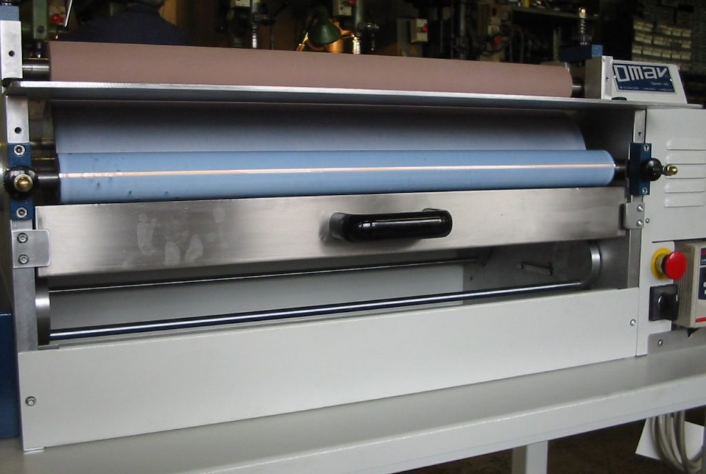 Rodillo frontal de máquina industrial para aplicar pegamento